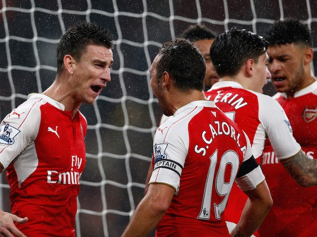 Laurent Koscielny (L) of Arsenal celebrates scoring his team's second goal with his team mates during the Barclays Premier League match between Arsenal and Everton at Emirates Stadium on October 24, 2015 in London, England.