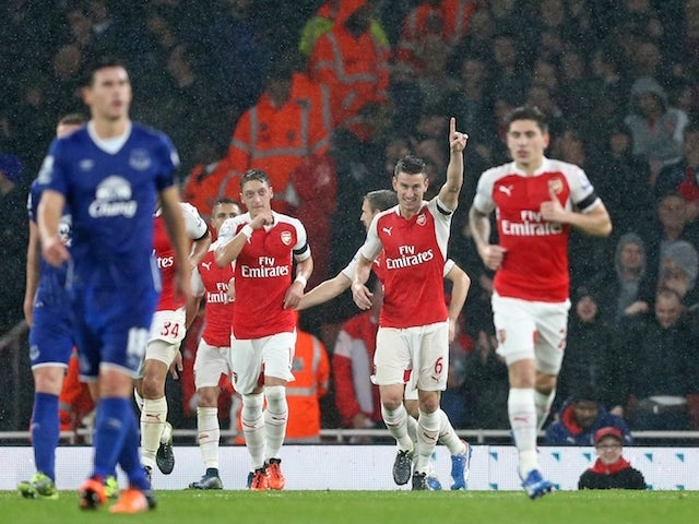 Arsenal's French defender Laurent Koscielny (2nd R) celebrates after scoring their second goal during the English Premier League football match between Arsenal and Everton at the Emirates Stadium in London on October 24, 2015.