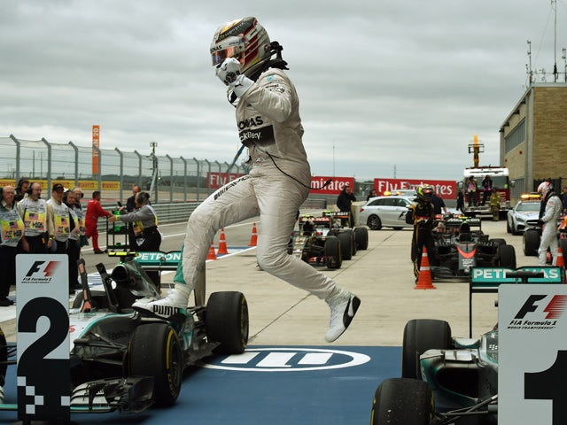 Mercedes AMG Petronas driver Lewis Hamilton of Britain leaps from his car as he celebrates winning the United States Formula One Grand Prix at the Circuit of The Americas in Austin, Texas on October 25, 2015