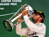 Lewis Hamilton of Great Britain and Mercedes GP celebrates after winning the United States Formula One Grand Prix and the championship at Circuit of The Americas on October 25, 2015