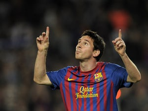 Barcelona's Argentinian forward Lionel Messi celebrates after scoring a goal during their Spanish League football match between FC Barcelona and Mallorca FC on October 29, 2011
