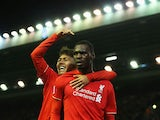 Christian Benteke (R) of Liverpool celebrates scoring his team's first goal with his team mate Roberto Firmino (L) during the Barclays Premier League match between Liverpool and Southampton at Anfield on October 25, 2015