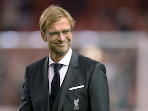 Liverpool's German manager Jurgen Klopp smiles during warm up prior to a UEFA Europa League group B football match between Liverpool FC and FC Rubin Kazan at Anfield in Liverpool, north west England, on October 22, 2015