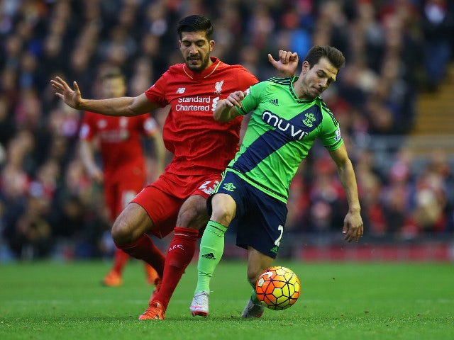 Cedric Soares of Southampton and Emre Can of Liverpool compete for the ball during the Barclays Premier League match between Liverpool and Southampton at Anfield on October 25, 2015 in Liverpool, England.