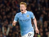 Manchester City's Belgian midfielder Kevin De Bruyne (R) celebrates after scoring during a UEFA Champions league Group D football match between Manchester City and Sevilla at the Etihad Stadium in Manchester, north west England on October 21, 2015.
