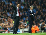 Unai Emery, coach of Sevilla gives instructions with Manuel Pellegrini, manager of Manchester City during the UEFA Champions League Group D match between Manchester City and Sevilla at Etihad Stadium on October 21, 2015 in Manchester, United Kingdom.