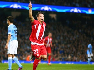 Yevhen Konoplyanka of Sevilla celebrates scoring the opening goal during the UEFA Champions League Group D match between Manchester City and Sevilla at Etihad Stadium on October 21, 2015 in Manchester, United Kingdom