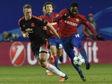 Manchester United's English defender Phil Jones (L) vies for the ball with CSKA Moscow's Nigerian forward Ahmed Musa during the UEFA Champions League group B football match between PFC CSKA Moscow and FC Manchester United at the Arena Khimki stadium outsi