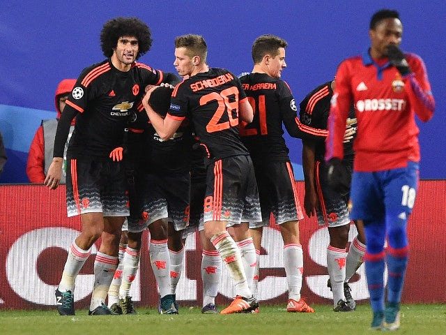 Manchester United's players celebrate after Manchester United's French forward Anthony Martial scored a goal during the UEFA Champions League group B football match between PFC CSKA Moscow and FC Manchester United at the Arena Khimki stadium outside Mosco