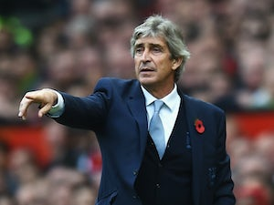 Manuel Pellegrini, manager of Manchester City gestures during the Barclays Premier League match between Manchester United and Manchester City at Old Trafford on October 25, 2015 in Manchester, England.