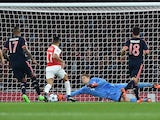 Bayern Munich's goalkeeper Manuel Neuer dives to save a shot from Arsenal's German midfielder Mesut Ozil (unseen) during the UEFA Champions League football match between Arsenal and Bayern Munich at the Emirates Stadium in London, on October 20, 2015.