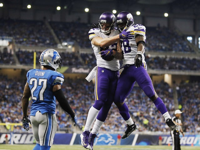 Kyle Rudolph #82 of the Minnesota Vikings celebrates a second quarter touchdown with Adrian Peterson #28 while playing the Detroit Lions at Ford Field on October 25, 2015