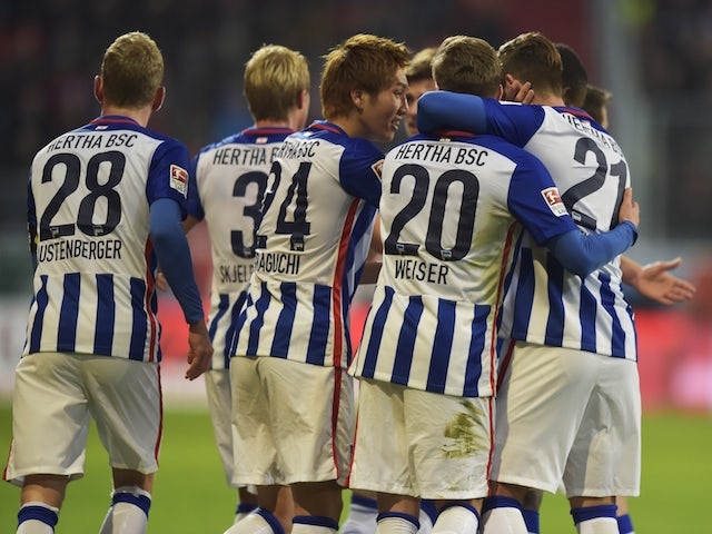 Berlin's German midfielder Mitchell Weiser (2nd R) celebrates scoring the opening goal with his team-mates during the German first division football Bundesliga match between FC Ingolstadt and Hertha BSC Berlin on October 24, 2015 in Ingolstadt, southern G
