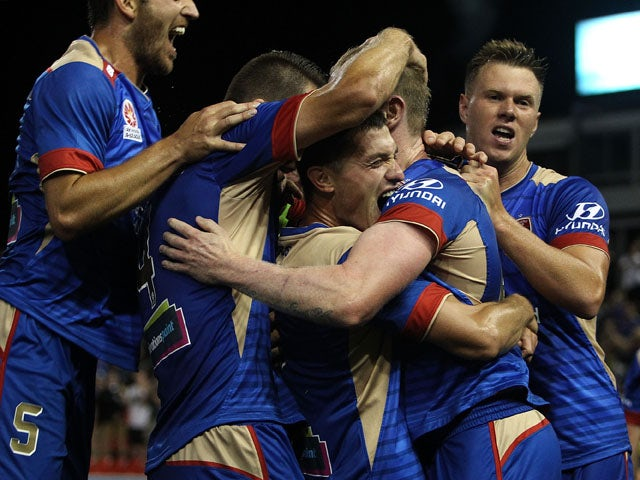 David Carney of the Jets celebrates a goal with team mates during the round three A-League match between the Newcastle Jets and the Melbourne Victory at Hunter Stadium on October 23, 2015