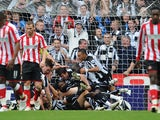 Newcastle players celebrate the first goal by Kevin Nolan during the Barclays Premier League match between Newcastle United and Sunderland at St James' Park on October 31, 2010