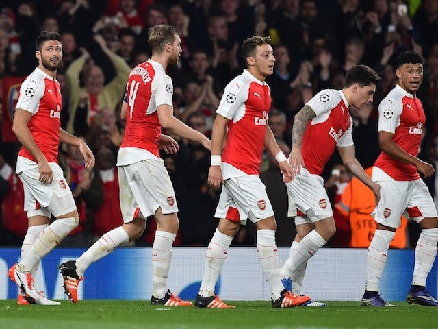Arsenal's French striker Olivier Giroud (L) reacts with teamates Arsenal's German defender Per Mertesacker, Arsenal's German midfielder Mesut Ozil, Arsenal's Spanish defender Hector Bellerin and Arsenal's English midfielder Alex Oxlade-Chamberlain after s
