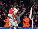 Arsenal's French striker Olivier Giroud (R) celebrates scoring his team's first goal with Arsenal's Chilean striker Alexis Sanchez during the UEFA Champions League football match between Arsenal and Bayern Munich at the Emirates Stadium in London, on Octo