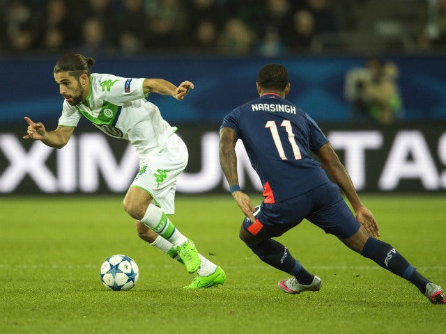 PSV Eindhoven's forward Luciano Narsingh (R) and Wolfsburg's Swiss defender Ricardo Rodriguez vie for the ball during the Group B, first-leg UEFA Champions League football match VfL Wolfsburg vs PSV Eindhoven in Wolfsburg, northern Germany on October 21,