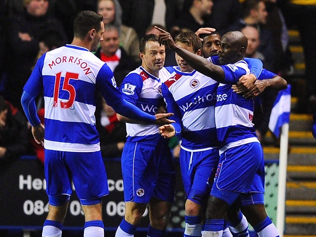 Jason Roberts of Reading celebrates scoring the first goal during the Capital One Cup Fourth Round match between Reading and Arsenal at Madejski Stadium on October 30, 2012