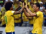 Brazil's Ricardo Oliveira (R) celebrates with teammate Willian after scoring against Venezuela during their Russia 2018 FIFA World Cup South American Qualifiers football match, at the Estadio Castelao stadium in Fortaleza, Brazil, on October 13, 2015.