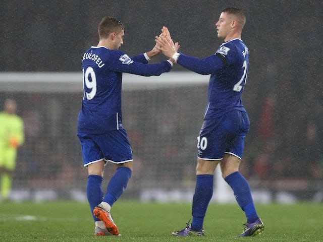 Everton's English midfielder Ross Barkley (R) celebrates with Everton's Spanish midfielder Gerard Deulofeu after he scores their first goal with a deflected shot during the English Premier League football match between Arsenal and Everton at the Emirates