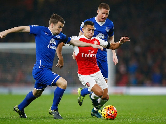 Seamus Coleman of Everton and Alexis Sanchez of Arsenal compete for the ball during the Barclays Premier League match between Arsenal and Everton at Emirates Stadium on October 24, 2015 in London, England.