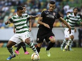 Sporting's Brazilian forward Matheus Pereira (L) vies with Skenderbeu's Kosovar defender Bajram Jashanica during the Europa League football match Sporting Clube de Portugal vs KF Skenderbeuon at the Jose Alvalade stadium in Lisbon on October 22, 2015