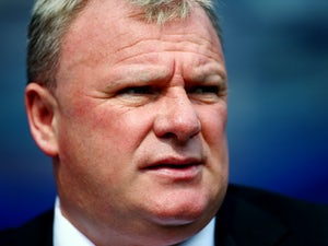 Steve Evans, manager of Rotherham United, looks on prior to the Sky Bet Championship match between Queens Park Rangers and Rotherham United at Loftus Road on August 22, 2015