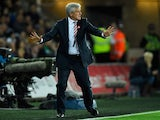 Mark Hughes manager of Stoke City reacts during the Barclays Premier League match between Swansea City and Stoke City at Liberty Stadium on October 19, 2015