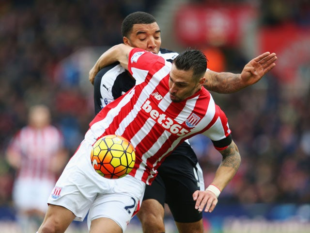 Geoff Cameron of Stoke City and Troy Deeney of Watford compete for the ball during the Barclays Premier League match between Stoke City and Watford at Britannia Stadium on October 24, 2015