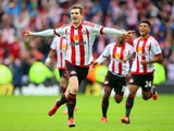 Adam Johnson of Sunderland celebrates scoring his team's first goal from the penalty spot during the Barclays Premier League match between Sunderland and Newcastle United at Stadium of Light on October 25, 2015 in Sunderland, England.