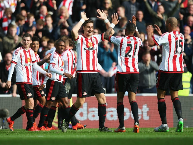 Sunderland players celebrate their team's second goal by Billy Jones (obscured) during the Barclays Premier League match between Sunderland and Newcastle United at Stadium of Light on October 25, 2015 in Sunderland, England.