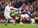 Jordan Ayew of Aston Villa and Gylfi Sigurdsson of Swansea City compete for the ball during the Barclays Premier League match between Aston Villa and Swansea City at Villa Park on October 24, 2015