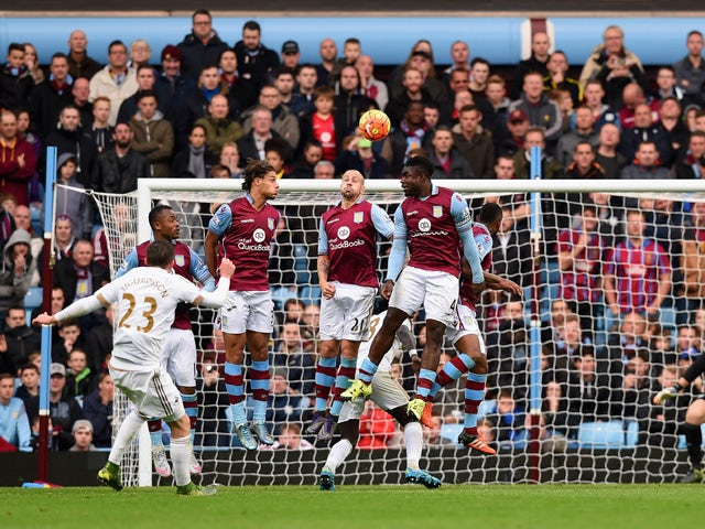 Gylfi Sigurdsson of Swansea City scores his team's first goal from a fee kick during the Barclays Premier League match between Aston Villa and Swansea City at Villa Park on October 24, 2015
