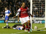 Theo Walcott of Arsenal celebrates their sixth goal during the Capital One Cup Fourth Round match between Reading and Arsenal at Madejski Stadium on October 30, 2012
