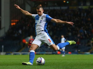 Tommy Spurr of Blackburn Rovers scores the second goal during the Sky Bet Championship match between Blackburn Rovers and Queens Park Rangers at Ewood Park on April 08, 2014