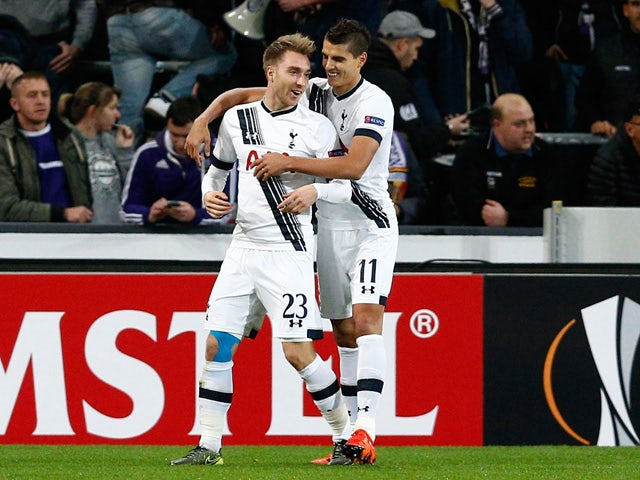 Christian Eriksen of Spurs is congratulated by Erik Lamela (R) of Spurs after scoring the opening goal during the UEFA Europa League Group J match between RSC Anderlecht and Tottenham Hotspur FC at the Constant Vanden Stock Stadium on October 22, 2015