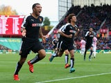 Troy Deeney of Watford celebrates scoring his team's first goal during the Barclays Premier League match between Stoke City and Watford at Britannia Stadium on October 24, 2015