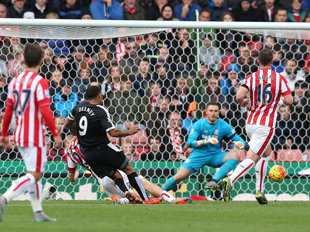 Troy Deeney of Watford scores the opening goal during the Barclays Premier League match between Stoke City and Watford on October 24, 2015