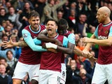 Mauro Zarate (2nd L) of West Ham United celebrates scoring his team's first goal with his team mates during the Barclays Premier League match between West Ham United and Chelsea at Boleyn Ground on October 24, 2015