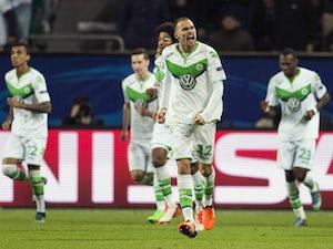 Bas Dost, Max Kruse give Wolfsburg win
