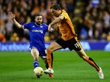 Kevin McDonald of Wolverhampton Wanderers beats the challenge from Alan Judge of Brentford during the Sky Bet Championship match between Wolverhampton Wanderers and Brentford at Molineux on October 21, 2015 in Wolverhampton, England.