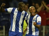 Porto's Algerian midfielder Yacine Brahimi (R) celebrates with teammate Cameroonian forward Vincent Aboubakar after scoring a goal during the UEFA Champions League group G football match FC Porto vs Maccabi Tel-Aviv FC at the Dragao stadium in Porto on Oc