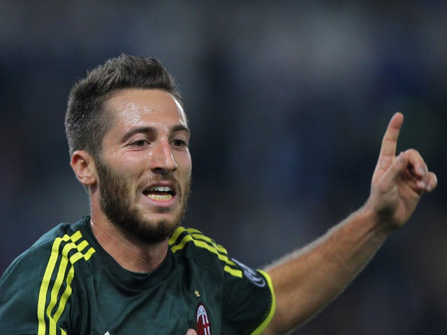 Andrea Bertolacci of AC Milan celebrates after scoring the opening goal during the Serie A match between SS Lazio and AC Milan at Stadio Olimpico on November 1, 2015