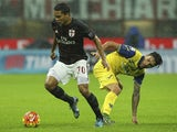 Carlos Bacca of AC Milan is challenged by Lucas Nahuel Castro of AC Chievo Verona during the Serie A match between AC Milan and AC Chievo Verona at Stadio Giuseppe Meazza on October 28, 2015 in Milan, Italy.