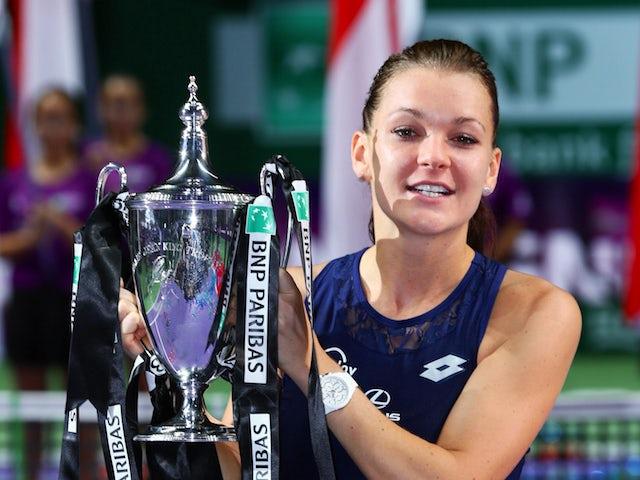 Agnieszka Radwanska Of Poland Holds The Billie Jean King Trophy After Defeating Petra Kvitova Czech