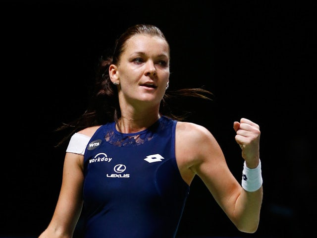 Agnieszka Radwanska of Poland celebrates match point against Simona Halep of Romania in a round robin match during the BNP Paribas WTA Finals at Singapore Sports Hub on October 29, 2015