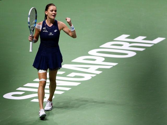 Agnieszka Radwanska of Poland celebrates match point at the semi-final match against Garbine Muguruza of Spain during BNP Paribas WTA Finals at Singapore Sports Hub on October 31, 2015