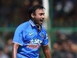 India's Amit Mishra (L) celebrates after bowling South Africa's Hashim Amla during the first one day international (ODI) cricket match between India and South Africa at Green Park Stadium in Kanpur on October 11, 2015