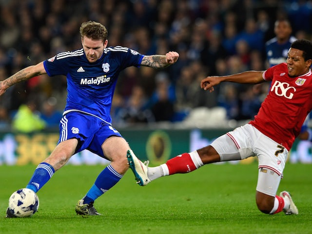 Bristol City player Korey Smith blocks the goalbound shot of Aron Gunnarsson of Cardiff during the Sky Bet Championship match between Cardiff City and Bristol City at Cardiff City Stadium on October 26, 2015 in Cardiff, United Kingdom.